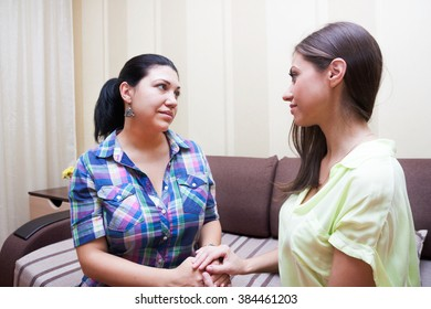 adult sister teaching younger sister