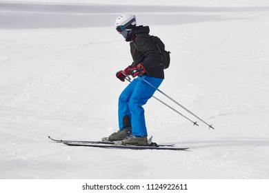 Adult skiing on a snowy hill landscape. Winter sport. Horizontal