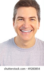 Adult smiling man. Isolated over white background