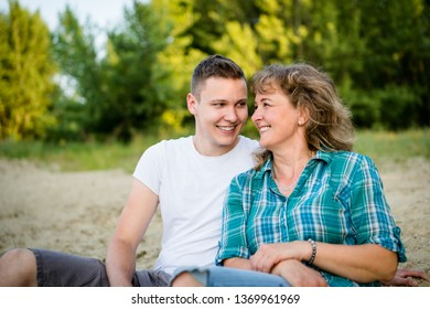 Adult son with his mother spending quality time, outdoors.