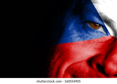 An adult sports fan with his face painted in the colors of the Czech Republic's flag