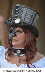 Adult steampunk woman with eyewear and hat posing at the elf fantasy fair Elfia in Arcen, Netherlands on the 20th of September 2014.