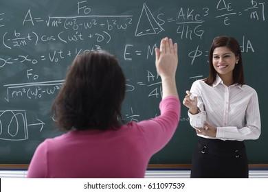 Adult student raising hand for teacher