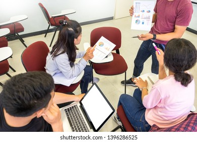 Adult students group listen to professor's lecture and Asking Question in small class room On University Campus.