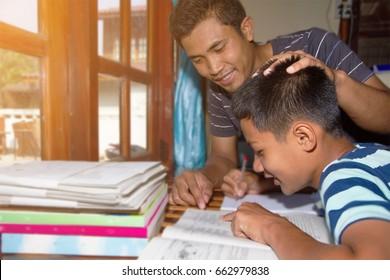 Adult teach homework child at home