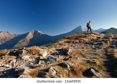 Adult trekker is standing on top of the mountain in Tatras Mountains, Poland
