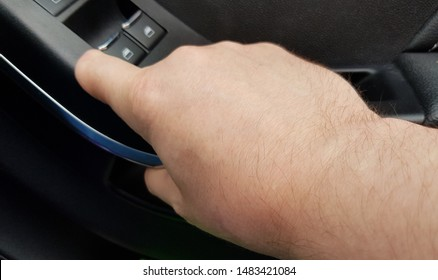 Adult white Caucasian male with a partially amputated left hand index finger closes car door by using the inside handle.