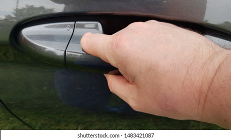 Adult white Caucasian male with a partially amputated left hand index finger opens a grey car door from the outside.