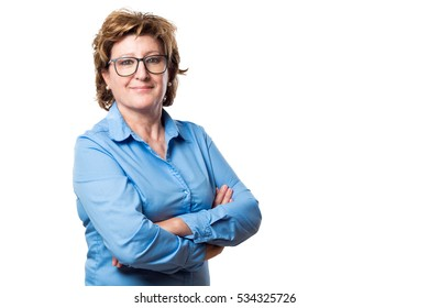 Adult woman with blue shirt and glasses with arms crossed isolated  on white background