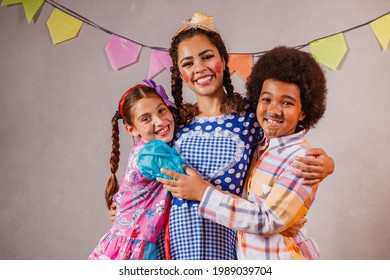 Adult woman and children dressed for June party