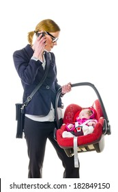 Adult woman in dark blazer sets her newborn daughter in a car safety seat, isolated against a white background.