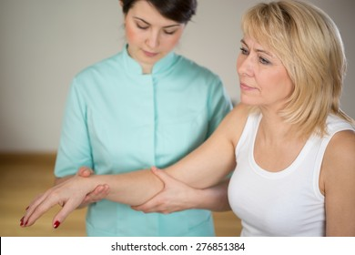 Adult woman during rehabilitation in physiotherapist's office