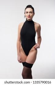 adult woman fitness black cloth and pantyhose studio