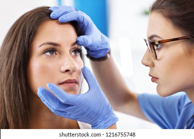 Adult woman having a visit at female oculist's office