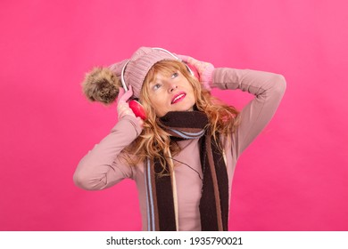 adult woman with headphones dancing on isolated