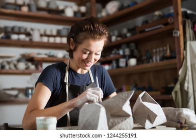 adult woman make pottery at table in workshop