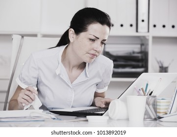 Adult woman office worker have problems in the office with napkin