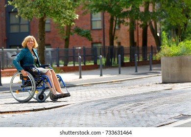 adult woman on wheelchair crossing the street in the city