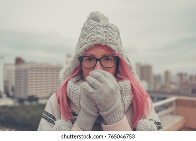 Adult woman pink hair glasses winter roof top