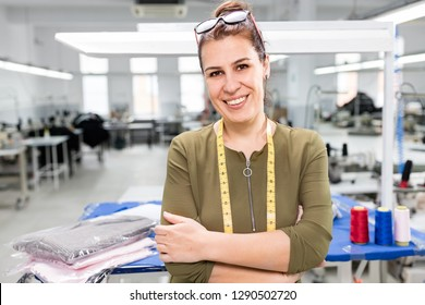 Adult woman posing in factory.
