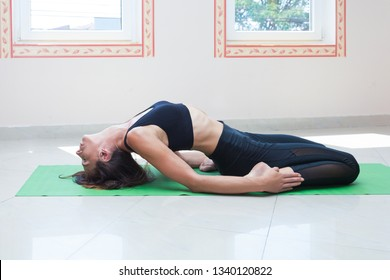 adult  woman practice yoga indoor stretch  full body shot natural light