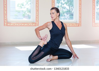 adult  woman practice yoga indoor full body shot natural light