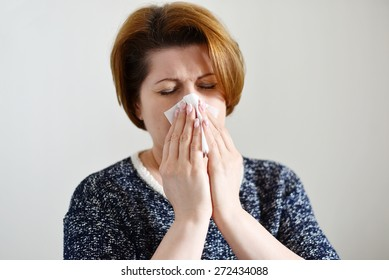 An Adult woman with a runny nose