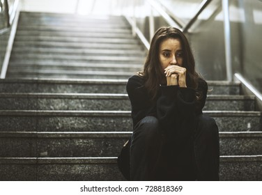 Adult Woman Sitting Look Worried on The Stairway