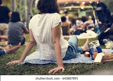 Adult Woman Sitting Picnic in The Park