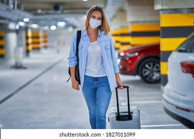Adult woman tourist wearing mask in underground airport parking lot