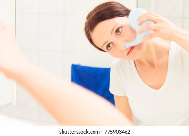 Adult Woman Using Neti Pot