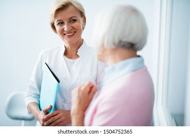 Adult woman visiting female dentist stock photo