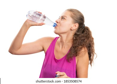 Adult woman wearing pink fitness tanktop attire drinking water for bottle after gym workout as active lifestyle healthy hydration concept isolated on white background