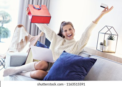 Adult woman wearing warm sweater and shoping online