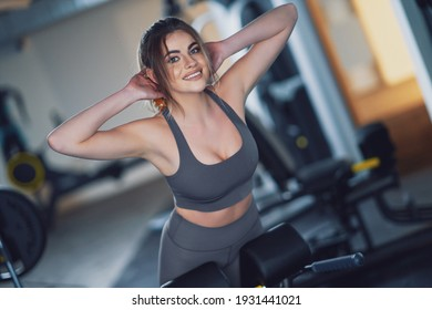 Adult woman working out in a gym