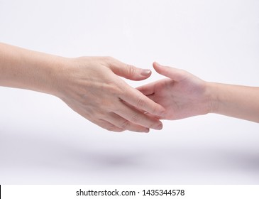 adult's hand holding kid's hand isolated on white background. Family concept, agreement, promise or cooperation idea.