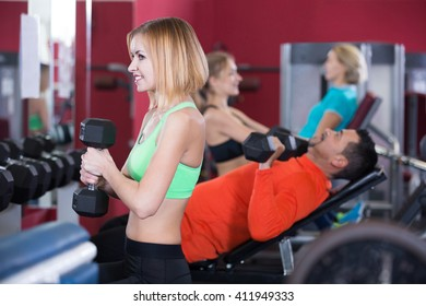 Adults people of different age having strength training in gym