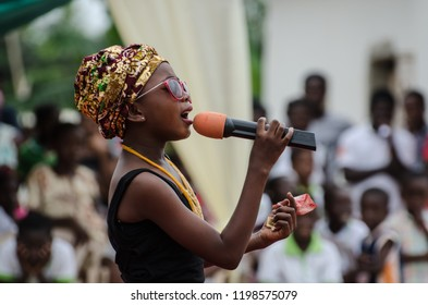 Adusah, Accra / Ghana - August the 8th 2018: Graduation at school - a girl singing.