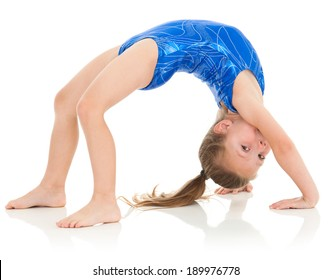Advanced skill for a young girl, it's never too early to start kids in athletics! She is pushing up into a bridge position. She looks over and makes eye contact with the viewer.