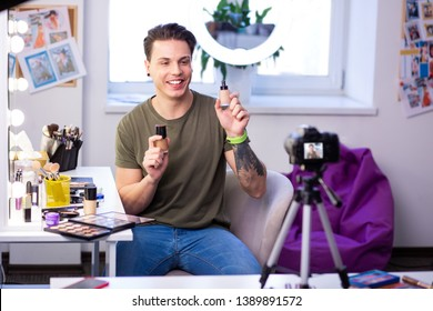 Advantages and disadvantages. Smiling active man being communicative on camera and discussing pros and cons of foundations