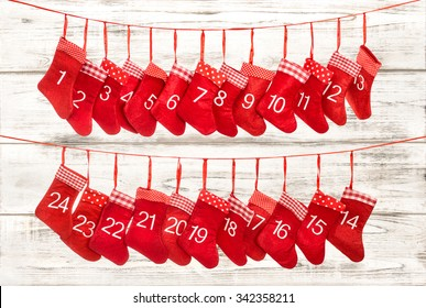 Advent calendar 1-24. Christmas decoration red stocking over wooden background