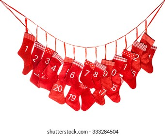Advent calendar. Red christmas stocking isolated on white background. Winter holidays