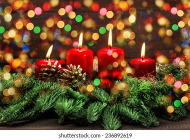 advent decoration with four red burning candles and colorful lights. selective focus, vintage style toned picture. holidays background