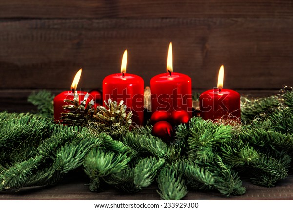 advent decoration with four red burning candles. holidays background. selective focus, vintage style toned picture