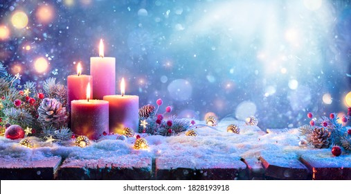 Advent - Four Purple Candles With Christmas Ornament In Shiny Night
