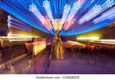 Advent market abstract lights with lens zoom effect with trail of lights,people movement at night. Blured festive highlight results with year 2019 and Kucica Slavonska (Home from Slavonia) lisible
