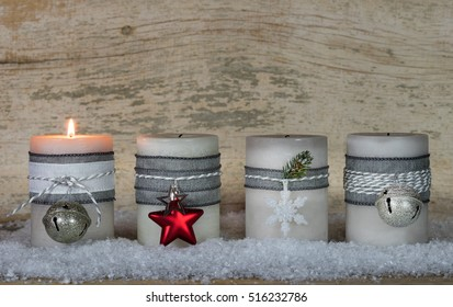 Advent season Christmas candles one flame is burning