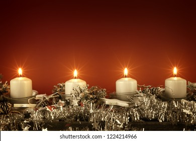 Advent time four candles burning with red background for your content
