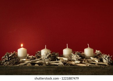 Advent time one candles burning with red background for your content