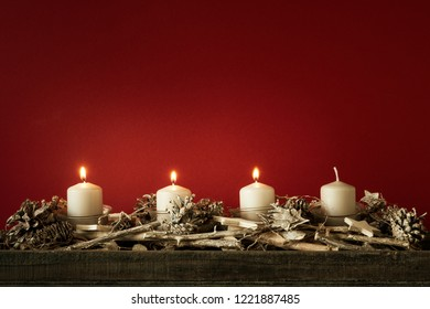 Advent time three candles burning with red background for your content